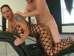 Sinful chick Simony Diamond stays in black fishnet suit in advance of starting to have fun with her boyfriend. She gives a head to him in advance of getting ass dildoed and fucked.