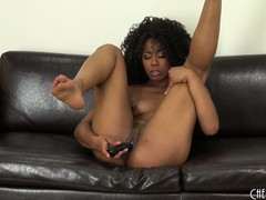 Misty Stone likes playing solo on the phat leather couch with her sexy cunt